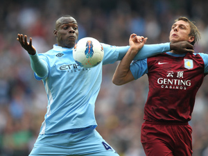 Mario Balotelli and Stephen Warnock