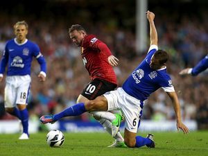 Wayne Rooney and Phil Jagielka