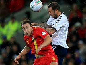 Wales's Darcy Blake battles with Scotland's Steven Fletcher