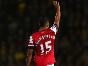 Arsenal's Alex Oxlade-Chamberlain signals to be subbed