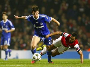 Francis Coquelin tries to hold back Klaas-Jan Huntelaar