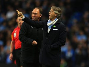 Roberto Mancini and first-team coach David Platt on the touchline