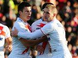 Sam Tomkins congratulates Tom Briscoe on scoring a try for England