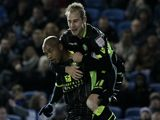 Luke Varney mounts El-Hadji Diouf after he scores