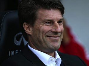 Swansea boss Michael Laudrup grinning