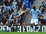 Steven Caulker celebrates scoring for Spurs as Aguero stands dejected