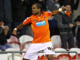 Nathan Delfouneso celebrates scoring for Blackpool