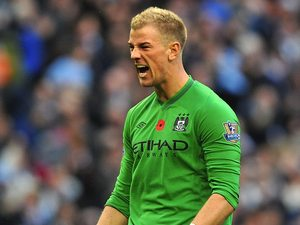 Joe Hart is happy after Dzeko puts City ahead
