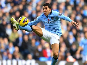 Carlos Tevez appears shocked