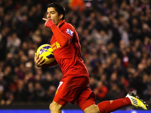 Luis Suarez scores the equaliser for Liverpool