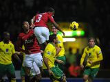 Patrice Evra has a headed attempt at goal on November 17, 2012