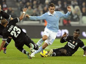 Lazio's Miroslav Klose gets caught in a tangle on November 17, 2012