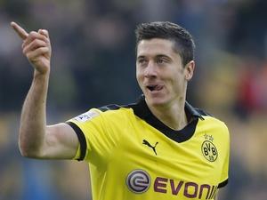 Robert Lewandowski celebrates putting Borussia Dortmund 1-0 up against Greuther Furth on November 17, 2012