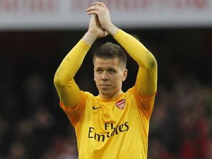 Arsenal keeper Wojciech Szczesny applauds at the end of their win over Spurs on November 18, 2012