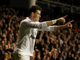 Gareth Bale celebrates moments after scoring his team's second goal on November 25, 2012