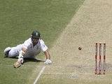 South Africa's Graeme Smith dives to avoid being run out on November 23, 2012