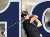Justin Rose tees off at the 18th during the World Tour Championship in Dubai on November 25, 2012