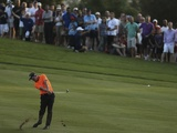 Co-leader after three rounds Luke Donald plays a shot on Hole 18 of the DP World Golf Championship on November 24, 2012