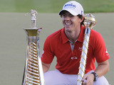 Rory McIlroy with the trophy after winning the final round in the World Tour Championship in Dubai on November 25, 2012