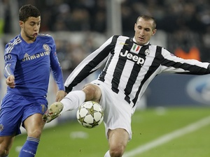Chelsea's Eden Hazard and Juventus' Giorgio Chiellini battle for possession on November 20, 2012