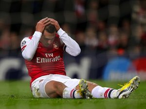 Lukas Podolski on the ground after missing a chance for Arsenal on November 21, 2012