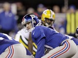 New York Giants' Eli Manning bends over on November 25, 2012
