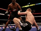 Freddie Flintoff is knocked down during the second round of his match with Richard Dawson on November 30, 2012