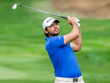 Jason Day watches his ball after taking his second shot on the first hole on November 29, 2012