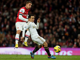Leon Britton attempts to block Lukas Podolski's shot on goal on December 1, 2012
