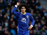 Marouane Fellaini celebrates after scoring the opener for his team on December 1, 2012