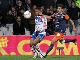 Lyon's Michel Bastos and Montpellier's Marco Estrada battle for the ball on December 1, 2012