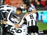 Papiss Cisse is mobbed by team mates after scoring the opener against Stoke on November 28, 2012