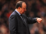 Rafa Benitez looks at his watch on December 1, 2012