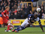 Charlton's Rob Hulse has his shot blocked by Millwall's Danny Shittu on December 1, 2012