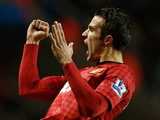 Robin Van Persie celebrates after scoring his team's fourth goal on December 1, 2012