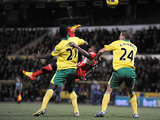 Stephane Sessegnon is closed down by Norwich as he attempts an overhead kick on December 2, 2012