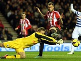 Sunderland's Steven Fletcher has his shot saved by QPR's Robert Green on November 27, 2012
