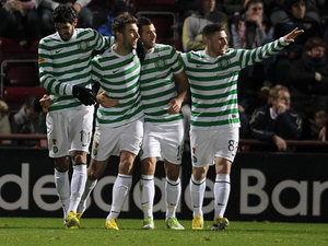 Celtic players celebrate their third goal against Hearts player Ryan Stevenson scores an own goal on November 28, 2012