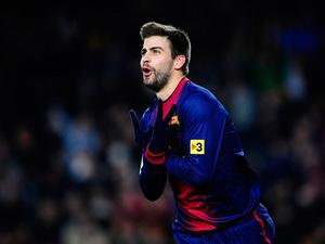 Barcelona's Gerard Pique celebrates after scoring the opener on December 1, 2012