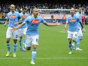 Napoli's Gokhan Inler celebrates scoring against Pescara on December 2, 2012