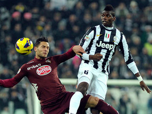 Juventus' Paul Pogba and Torino's Danilo D'Ambrosio battle for the ball on December 1, 2012