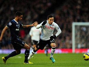 Kyle Naughton and Kerim Frei battle for the ball on December 1, 2012