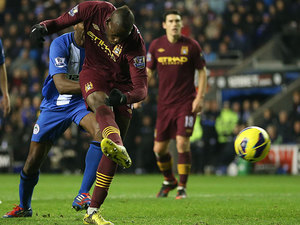 Mario Balotelli strikes to score the opener against Wigan on November 28, 2012
