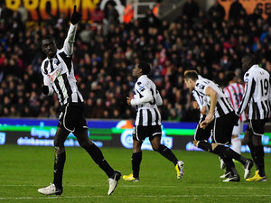Papiss Cisse salutes fans as he celebrates his goal against Stoke on November 28, 2012