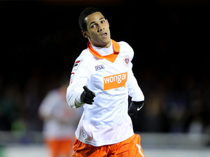 Thomas Ince celebrates after scoring his second goal on December 1, 2012