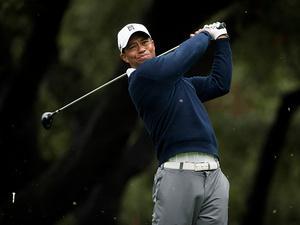 Tiger Woods watches his ball after teeing off at the sixth hole on November 29, 2012