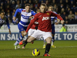 Wayne Rooney takes a penalty to score his team's second goal on December 1, 2012