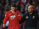Saints skipper Adam Lallana leaves the field early through injury on December 8, 2012