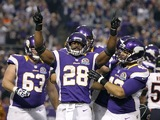 Vikings back Adrian Peterson celebrates his first touchdown of the night against the Bears on December 9, 2012