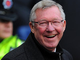 Manachester United manager Alex Ferguson smiles before kick off against rivals Manchester City on December 9, 2012